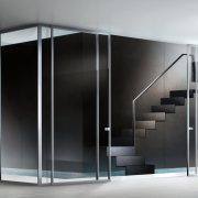 minimalist-sliding-glass-door-featuring-a-transparent-glass-panel-with-stainless-steel-frame